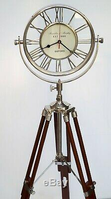 Vintage brass floor clock roman numerals with wooden tripod stand home decor