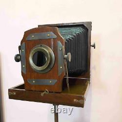 Appareil-photo Antique Antique De Pliage De Modèle De Cru Avec L'article En Bois De Collection De Trépied